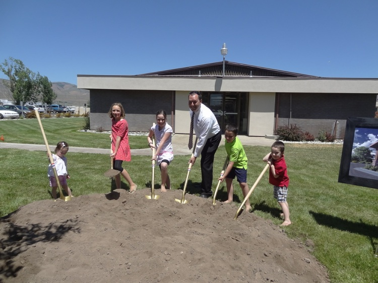 The Clayton children join in the action to turn shovels to start the construction. From left to right: Sarah, Ana, Lexie, David, Zachary, and Tommy.